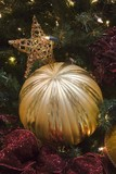 golden stripped ball ornament poster