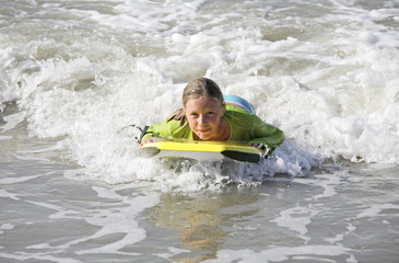 girl surfing on a boogie board