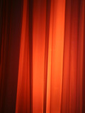 spot light against curtain poster