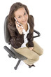 woman sitting on the office chair - talking to the mobile phone