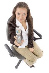 woman sitting on the office chair - showing mobile's screen