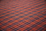 brown fabric background. shallow dof. poster