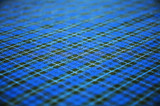 blue checkered fabric background. shallow dof. poster