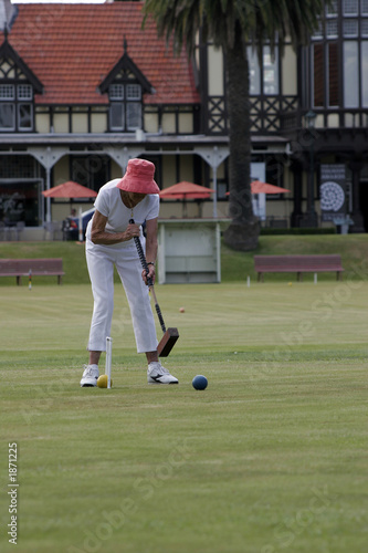 lady playing croquet