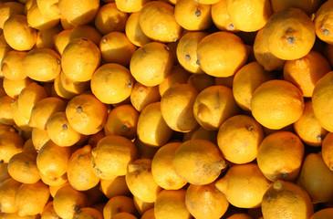 lemons at a market stall