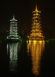 twin pagodas with reflection poster