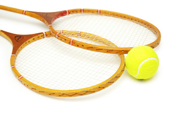 two tennis rackets and ball isolated on white
