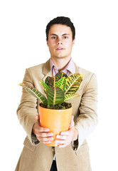 handsome young man with a plant