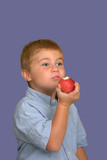 boy eating apple poster