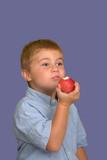 boy eating apple poster