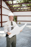 construction inspector with blueprints poster