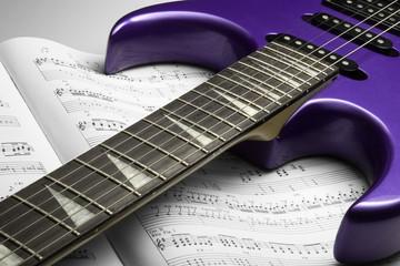electric guitar on sheet music