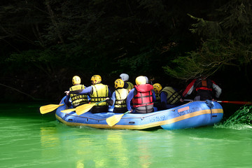 group of kayakers in a boat