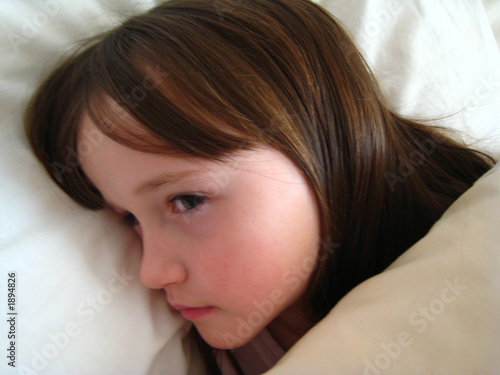 young girl in bed