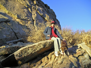 hiker taking a brake with her dog