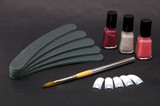 manicure accessories on black poster