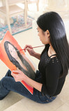 woman painting portrait (focus on painter) poster