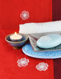 burning candle with soap in a dish poster