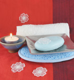 burning candle and white flowers with soap in a dish poster
