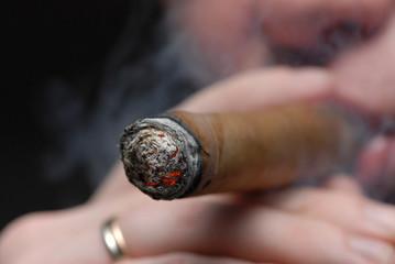 man smoking a cigar.