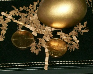 gold dollars & golden egg