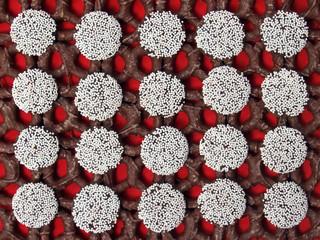 nonpareils and dark chocolate pretzels on red