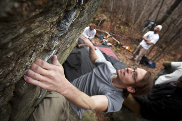 a young man bouldering - rock climbing series