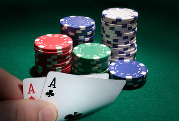 looking at pocket aces during a poker game.