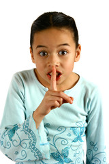 a young girl gesturing a request for silence