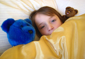 girl in bed with teddys