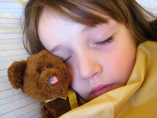 girl sleeping with teddys