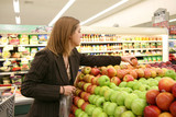 woman grocery shopping poster