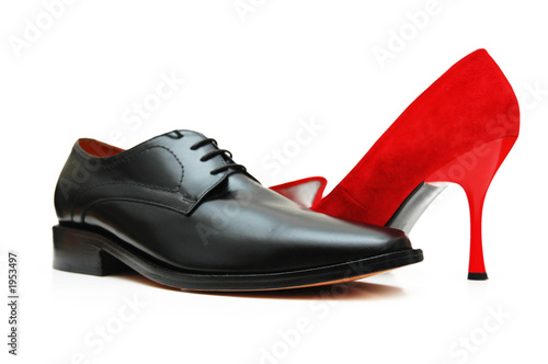 Leinwanddruck Bild black male shoe and red female shoe isolated on wh