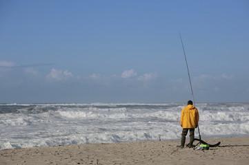 fisherman with yellow raincoat