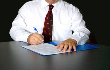 man signs contract