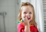 small girl washing her teeth poster