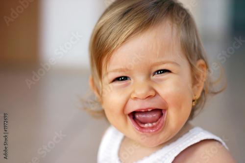Leinwanddruck Bild laughing baby