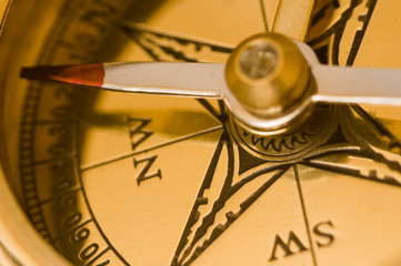 old style brass compass closeup