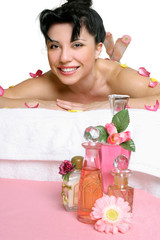 beautiful smiling woman relaxing at spa
