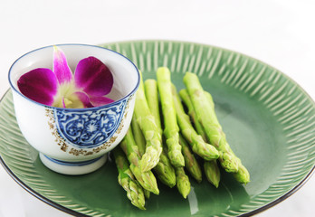 fresh asparagus shoots on a plate
