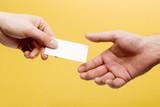 handing a business card poster