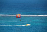 parasailing at tropical resort poster