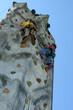 climbers on climbing wall