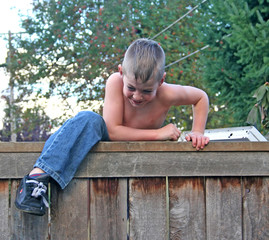 boy on fence