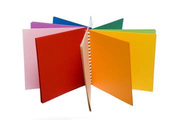 colour pencils and colored notebook