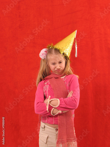 upset girl in birthday cap