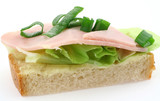 macro of tasty ham sandwich with lettuce and chive poster