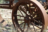 old wheel  - a part of rust plow poster