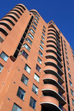 apartment building with curved balconies poster