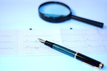 cardiogram,  pencil and magnifying glass